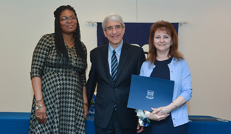 Judith Puglisi receives the Elm Award from Tyisha Walker-Myers and Peter Salovey