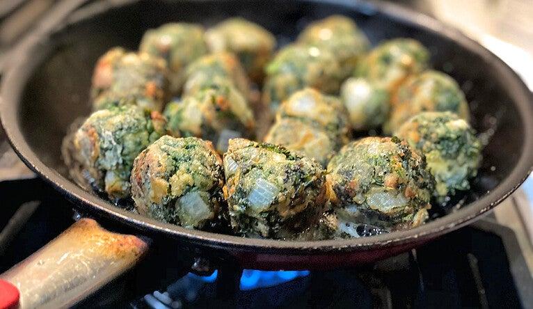 Tyler Bleuel '20 fries up kale 'meatballs' à la Yale Hospitality.