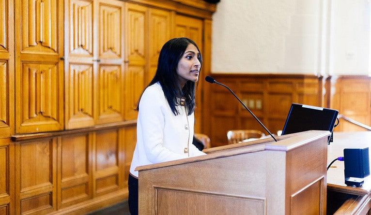 Krish Vignarajah '01 B.A., '08 J.D. speaking at Yale