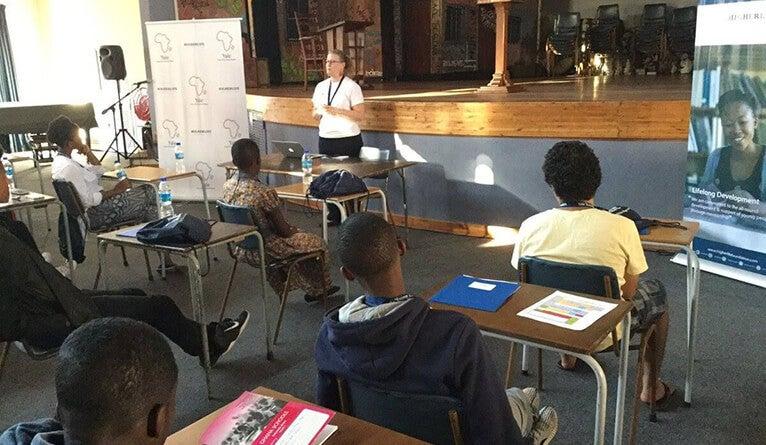 Program manager Laura Kaub addresses a group of YYAS students.