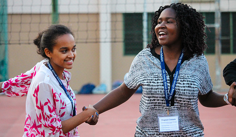 Photo of a female African secondary school student and her female teacher.