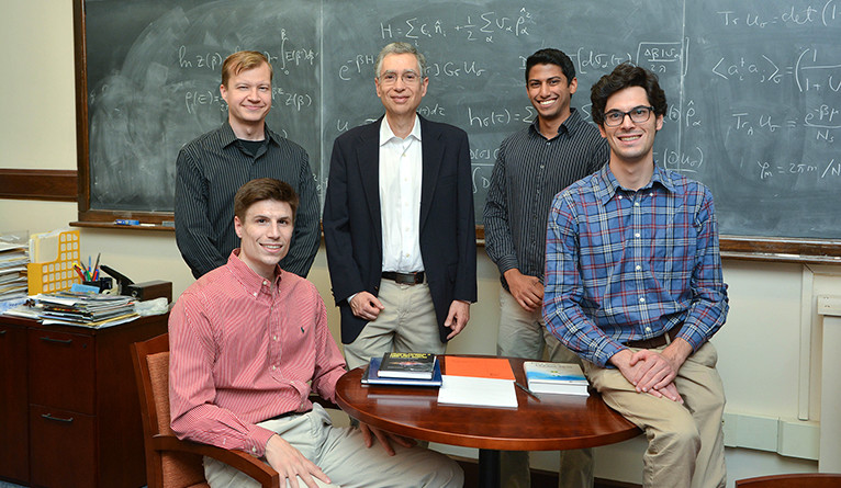Photo of Professor Yoram Alhassid and four of his research team.