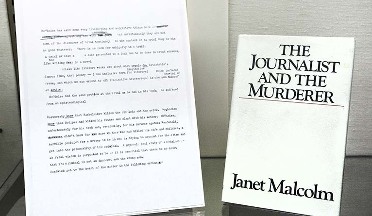 """A copy of """"The Journalist and the Murderer,"""" displayed alongside a page of of her notes from her research for the book."""