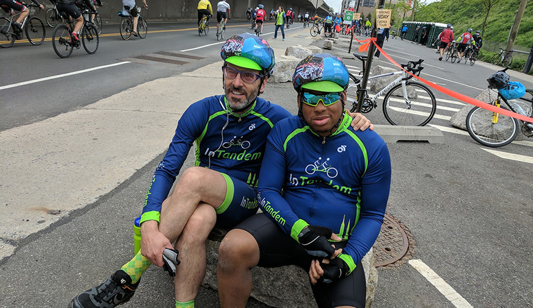 """Mark Carhart '88 B.A. (left), founder of InTandem with his """"stoker,"""" blind rider Hashim Kirkland at the TD Five Boro Bike Tour."""