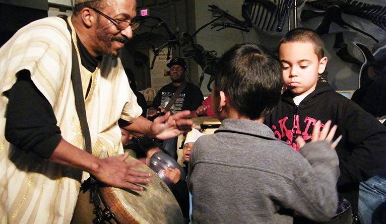 Michael Mills drumming with children