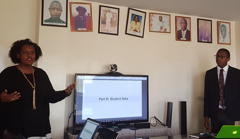 Rabb presents preliminary findings to Dr. Dahn at the Liberian Ministry of Health in October 2017