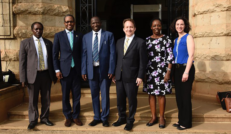 Pericles Lewis and a team from Yale posing with leaders at Makerere University in Uganda in March 2019.