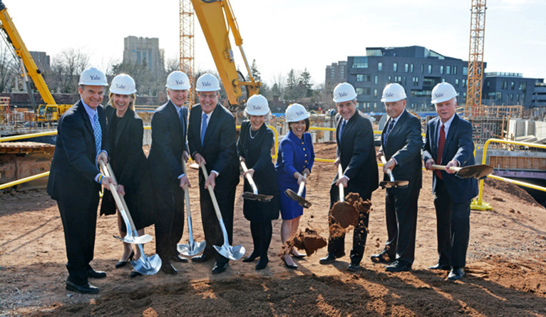 Groundbreaking of two new Yale colleges, with Richard Level, Peter Salovey, and others posing.