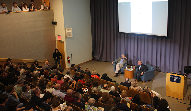 Rogers (on stage, left) and Pozner take questions from the audience at Luce Hall.