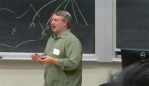 Photo of Professor Brian Scassellati speaking in front of a blackboard