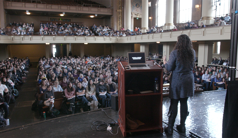 Professor Laurie Santos lectures in Woolsey Hall.