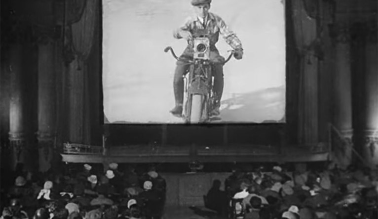 "A still from ""Man with a Movie Camera"" where an audience is watching ""Man with a Movie Camera."""