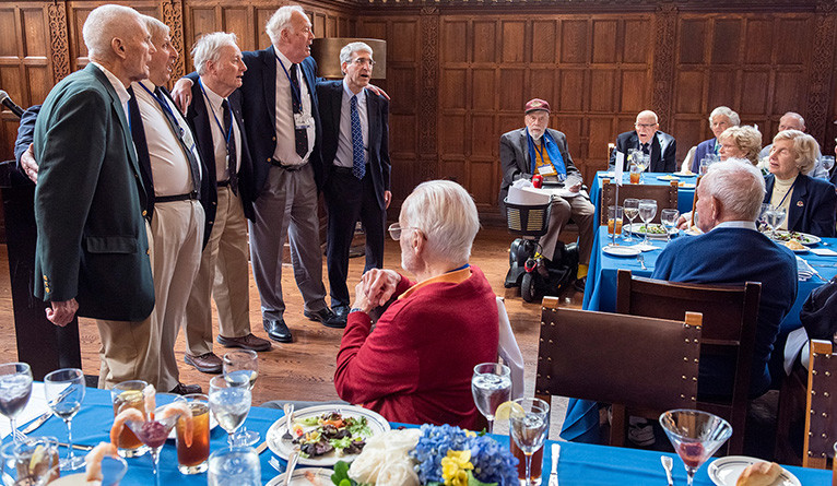 A group of alumni at this year's Senior Luncheon join President Peter Salovey for an impromptu song.