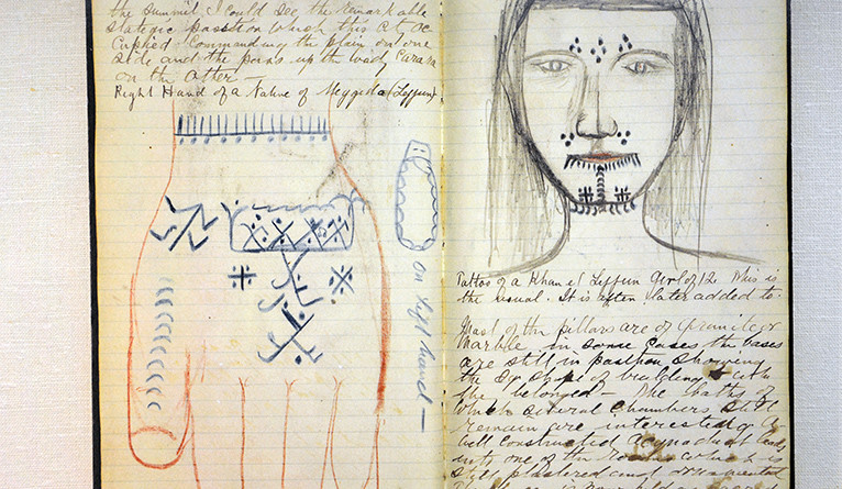 Pages of a diary featuring sketches of tattoos
