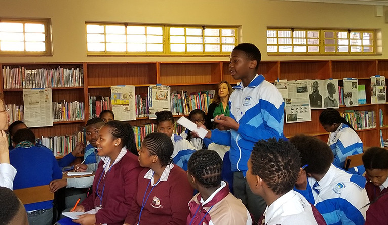 South African students journalism fundamentals and their student run newspaper in a classroom.