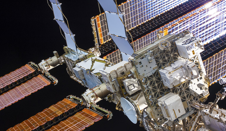 """Truss,"" another mural on view, depicts the International Space Station's solar arrays"