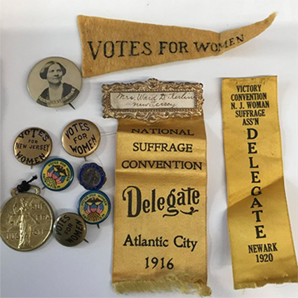 Votes for Women pins and pennants of Sarah Jenney Gilbert Kerlin in the Wilder Family Papers
