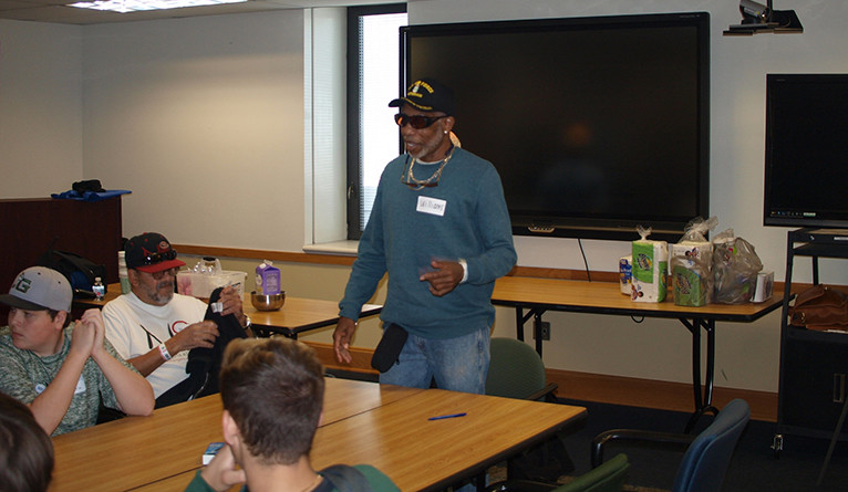 A veteran talks to a group of volunteers at the VA hospital in West Haven, CT.