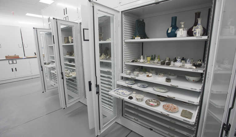 Storage unit with shelves extended to show objects being stored