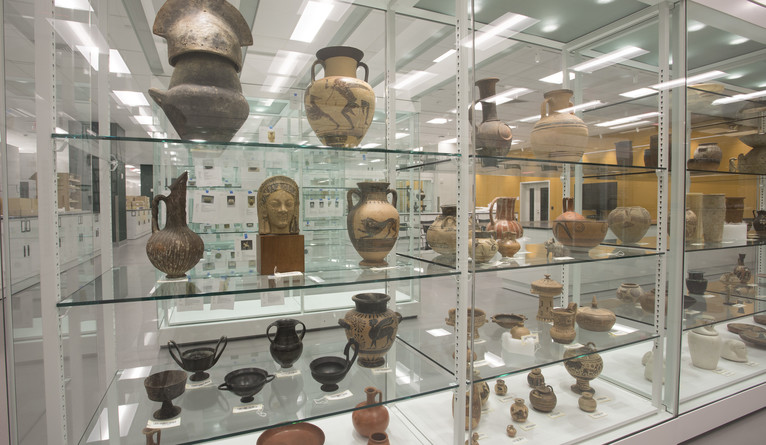 A display of jars and bowls from different cultures