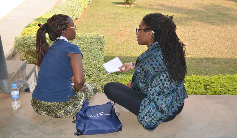 Yaa Oparebea Ampofo talking with a student.