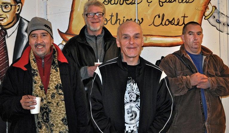 Four men posing for a portrait.