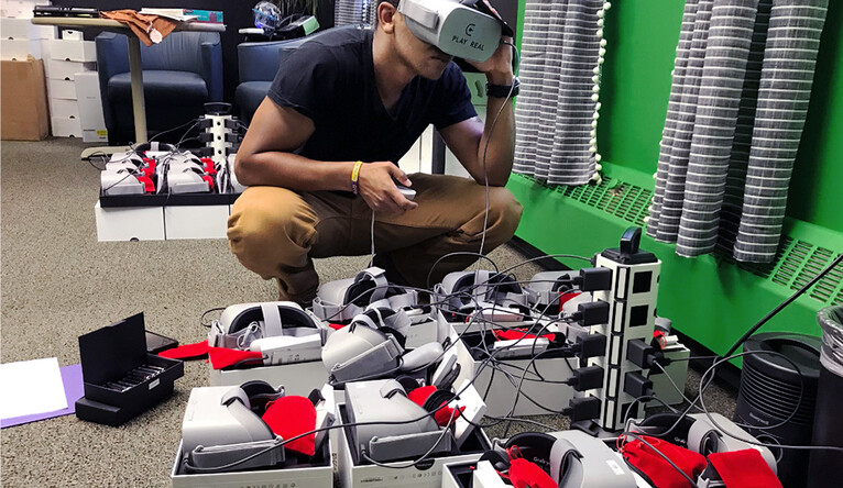 Inspecting VR headsets.   - yn vr 2 cc - A safe space: Medical researchers use virtual reality to reach youth