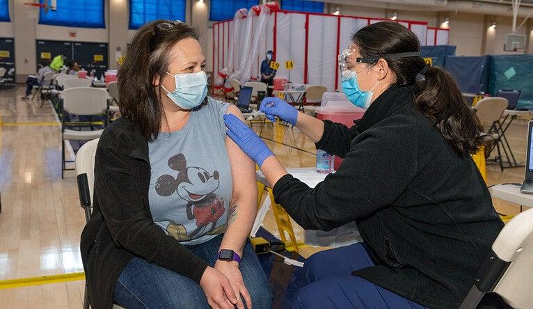 A Yale Health nurse administers a vaccination.