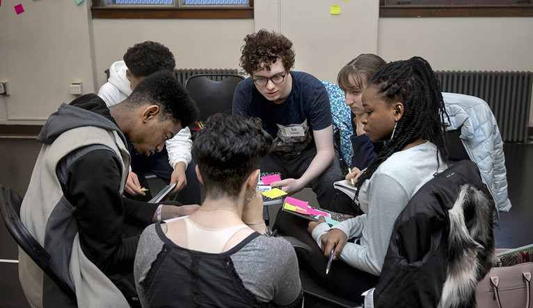 Students during an activity at a playwrighting workshop