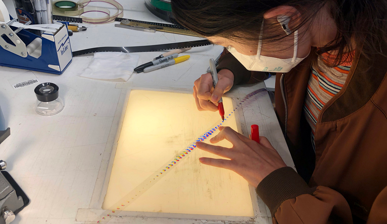 Student working with a light box.