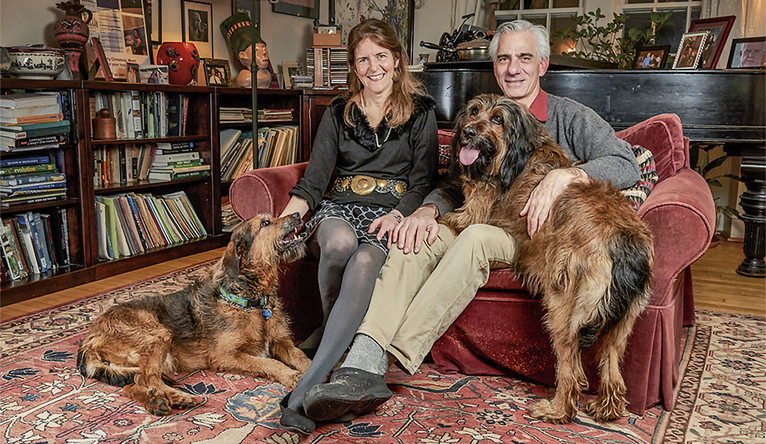 Drs. Jean Bennett and Albert Maguire with their Swedish Briard dogs, Venus and Mercury.