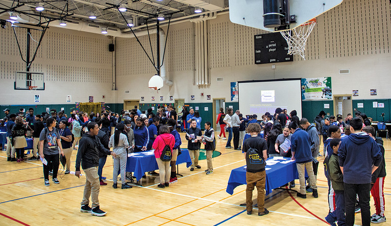 Code Haven students show off what they've learned in the gymnasium of New Haven's  Bishop Woods school