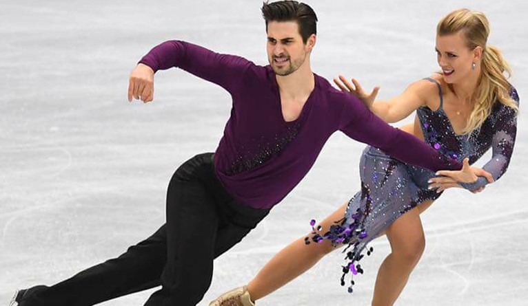 Zachary Donohue and Madison Hubbell performing an ice dancing routine.