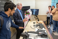 William Nordhaus receives flowers from students on the day of his Nobel Prize announcement.