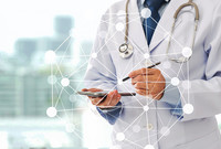A doctor working on a tablet with networked AI imagery imposed on top