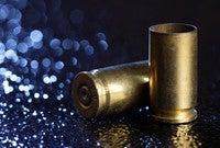 Two bullet casings on the sidewalk.
