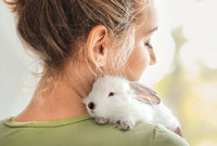 A woman holding a bunny