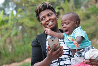 A new mom in Uganda getting a health message through access.mobile, a startup founded by two former Yale graduates.