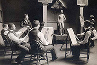 An early 20th-century photo of male art students painting a live male model.