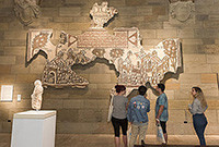 Visitors viewing an artwork at the Yale University Art Gallery.