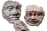 Three stone masks from Ancient Mesopotamia.