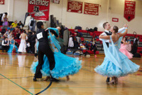 College students in formal wear performance in a ballroom dance competition.