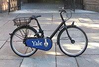 A bicyle on a sidewalk.