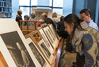 Art gallery patrons viewing prints and drawings.