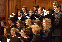 Male and female singers performing in a choir.