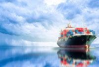 A modern cargo ship on the open sea.