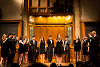 The Yale Citations a cappella group on stage.