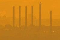 Industrial smokestacks polluting the air.