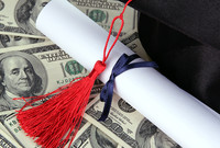 A mortarboard and college diploma sitting on a bed of money.