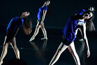 Four female dancers performing.